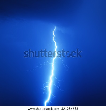 Lightning bolt in a storm - stock photo