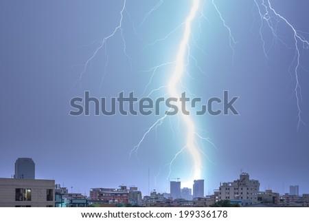 Lightning bolt over Bangkok city - stock photo