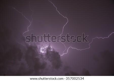 Lightning Bolt with Purple Sky - stock photo