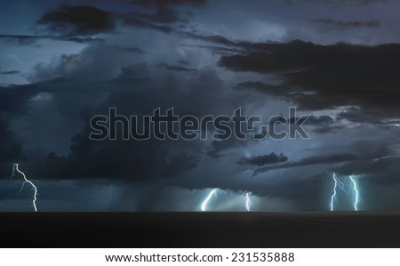 lightning bolts over the sea - stock photo