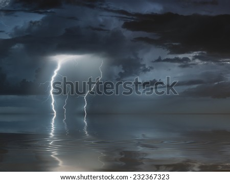 lightning bolts reflection over the sea