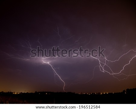 Lightning cutting across the sky during a storm.