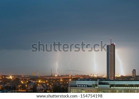 Lightning Flashes Across a Stormy Night Sky  - stock photo