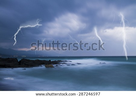 Lightning flashes across the beach from a powerful storm