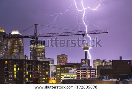 Lightning in Calgary. Lightning illuminating the Calgary Skyline - stock photo