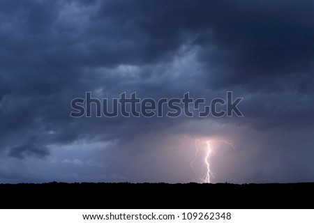 Lightning in the cloudy sky. - stock photo