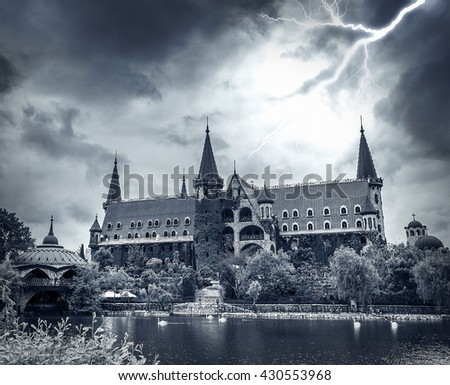 Lightning in the dark sky over the old stone castle. - stock photo