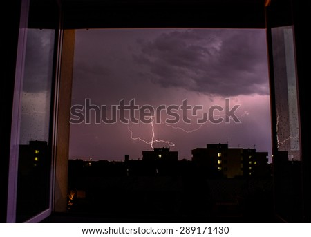 lightning light up the night during a summer storm - stock photo
