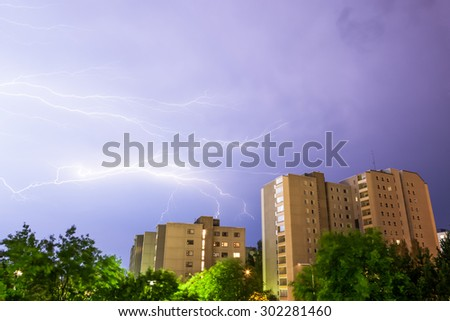 Lightning near buildings - stock photo