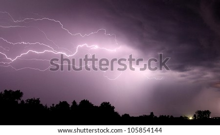 Lightning on the night sky - stock photo