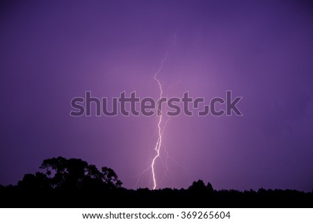 Lightning on the purple sky - stock photo