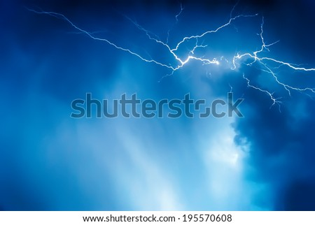 Lightning on the sky is covered with gray clouds in the rainy season - stock photo