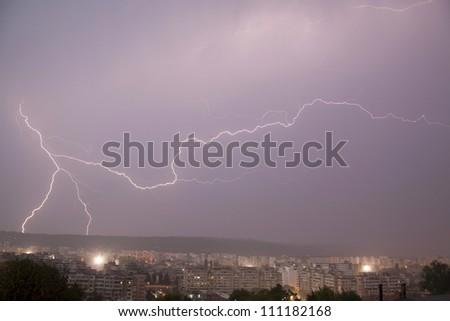 lightning over city - stock photo