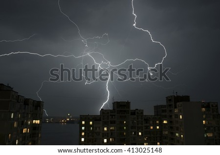 Lightning over houses - stock photo
