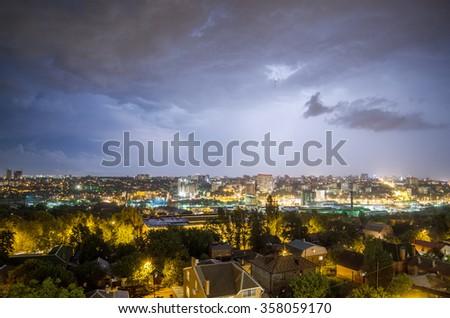Lightning over the city - stock photo