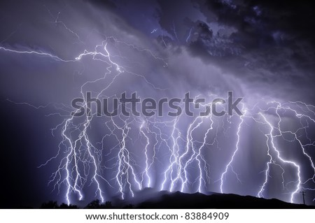 Lightning over the Rincon Mountains - stock photo