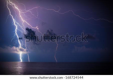 Lightning over the sea - stock photo