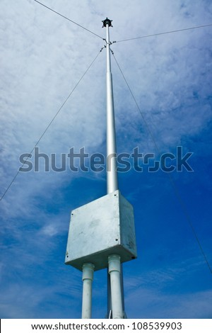 Lightning rod and blue sky