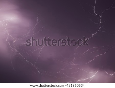 Lightning storm in the middle of the night. - stock photo