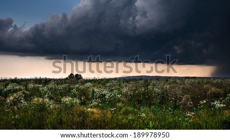 lightning storm over a summer field - stock photo
