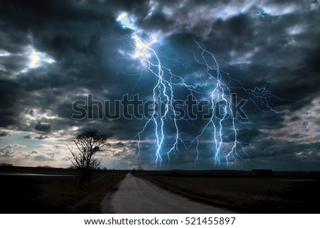 Lightning storm over asphalt road
