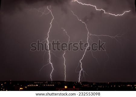 lightning storm over city  - stock photo