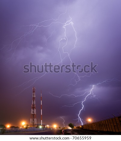 lightning storm over radio mast - stock photo