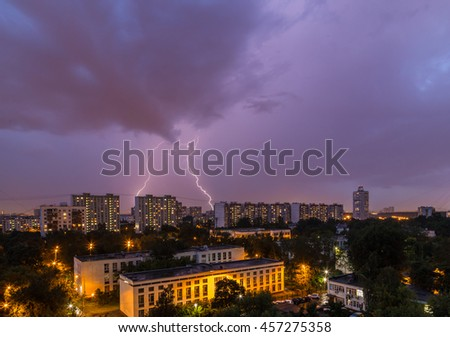 Lightning storm over the city in the evening sky