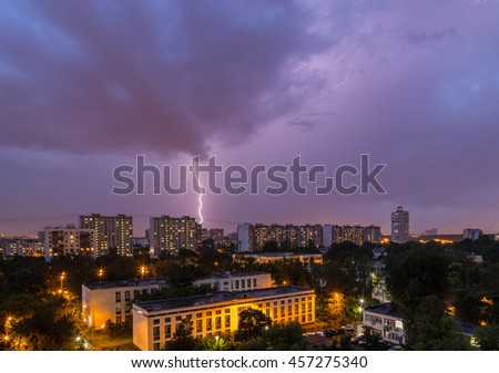 Lightning storm over the city in the night sky