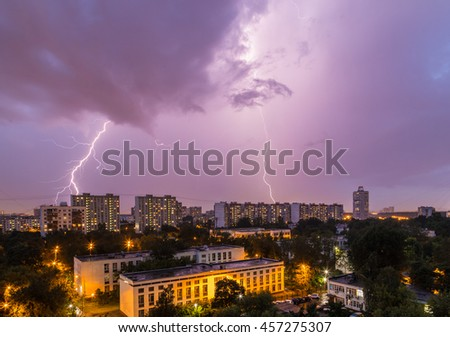 Lightning storm over the city in the twilight sky