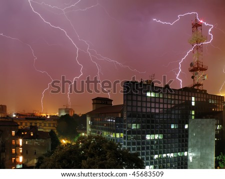 Lightning storm over TV station building in Belgrade, Serbia - stock photo