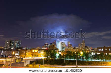 Lightning Strike Above the Denver Skyline Lights Up the Night Sky - stock photo