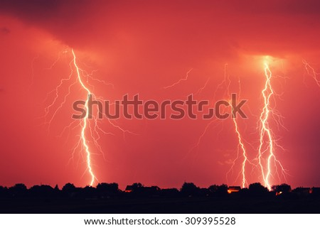 Lightning strike at night - stock photo