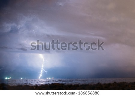 Lightning strike far away at the sea