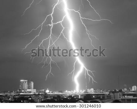 Lightning strike in the night rain (Black and White) - stock photo