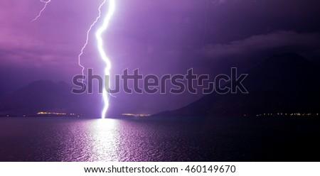 Lightning strike on Lake Atitlan, Guatemala. - stock photo