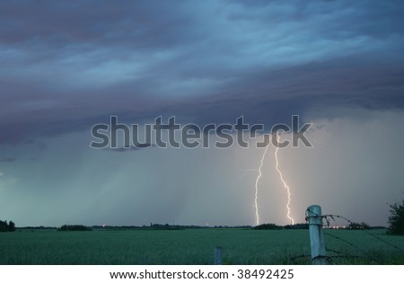 Lightning strike over a wheat field.
