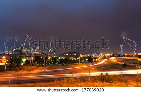 Lightning strikes above the Denver, Colorado downtown skyline during a strong thunderstorm - stock photo