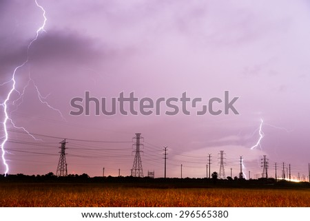 Lightning strikes behind the lines designed to carry it in South Texas - stock photo