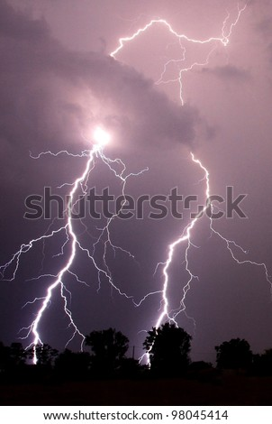 Lightning strikes in the darkness - stock photo
