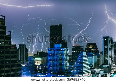Lightning strikes inside a crowded Asian city - stock photo