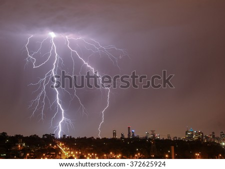 Lightning strikes over Melbourne city skyline - stock photo