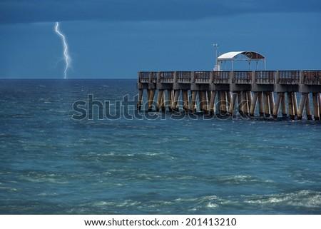 lightning strikes over the ocean (long single exposure). Delray Beach, Florida, United States - stock photo