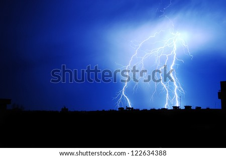 Lightnings in town - stock photo