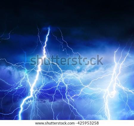Lightnings, thunder and rain during summer storm. - stock photo