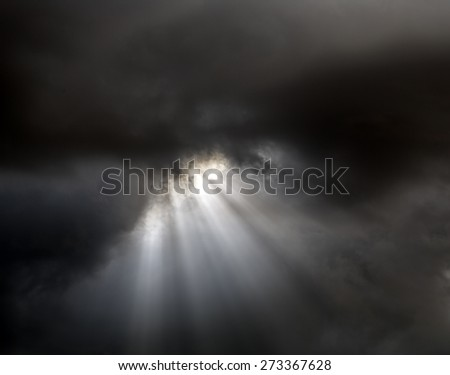 Lightrays through clouds Beautiful sky and cloudscape shots - stock photo