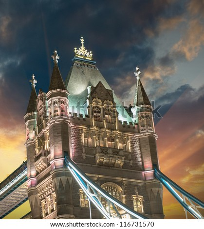 Lights and Colors of Tower Bridge at sunset with Clouds and sunrays - London - UK - stock photo