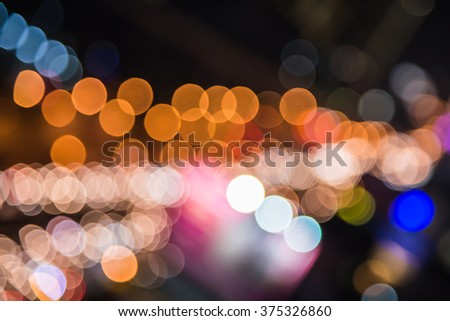 Lights blurred bokeh background from city night - stock photo