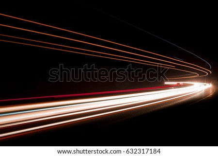 Lights. Car headlights. Car light trails on the road