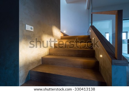 Lights illuminating the stairway at night